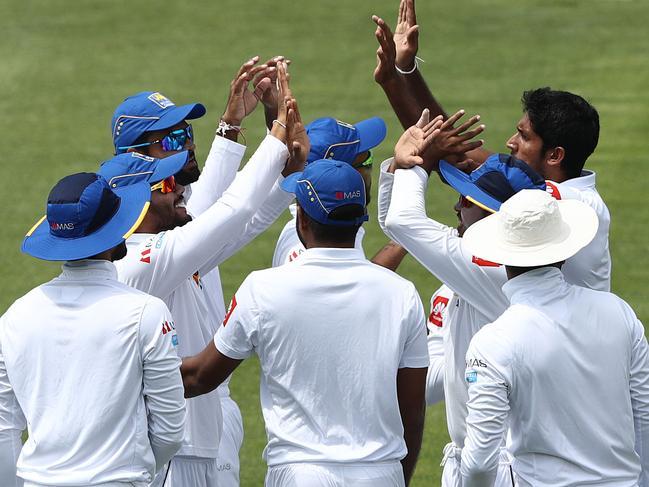 Sri Lanka celebrate the wicket of Joe Burns. Robert Cianflone/Getty Images