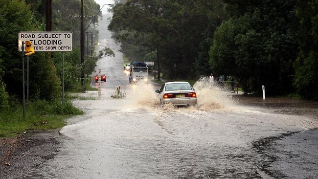 Three flood rescues as rain lashes NSW