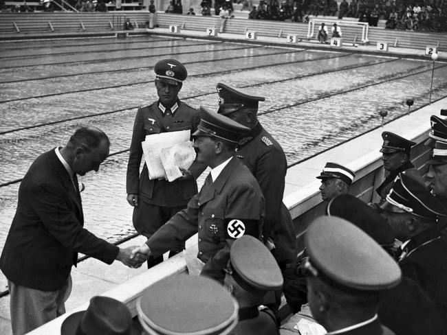Adolf Hitler the German Chancellor shakes hand with an official whilst spectating at the 1936 Olympic Games.