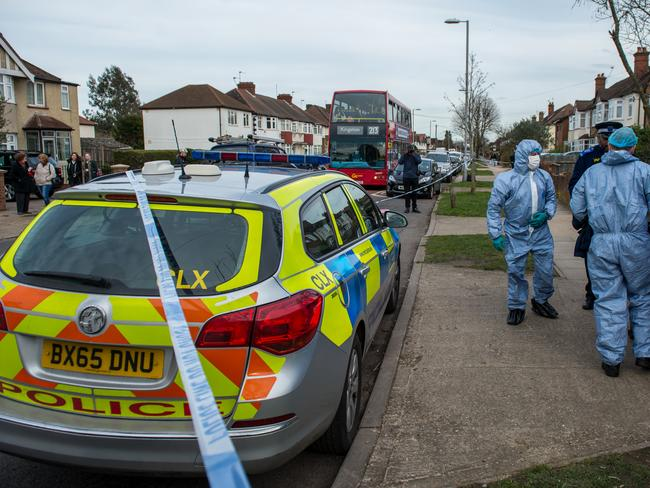 Two police forensics officers prepare to enter a police tent outside the home of Russian exile Nikolai Glushkov who was found dead at his home in New Molden. Picture: Getty