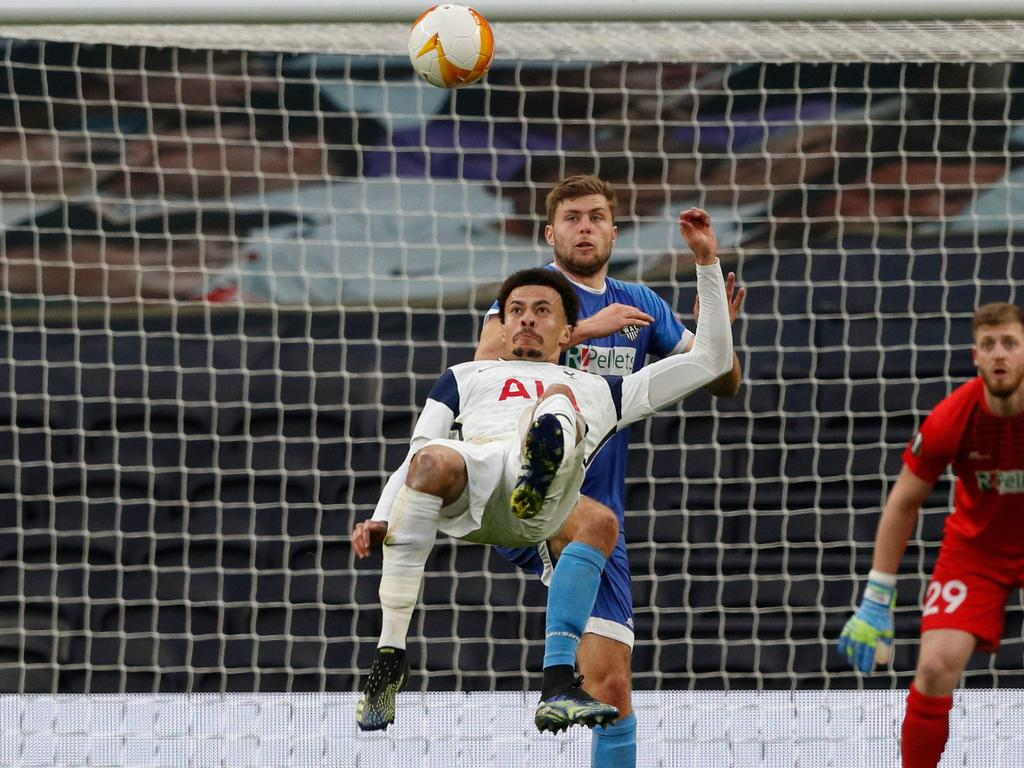 Tottenham Hotspur's English midfielder Dele Alli scores his team's opening goal during the UEFA Europa League Last 32 Second Leg football match between Tottenham Hotspur and Wolfsberg at the Tottenham Hotspur Stadium in London, on February 24, 2021. (Photo by Adrian DENNIS / AFP)