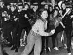 Fay Maslen of Elizabeth Vale breaks free of the police cordon as the Bay City Rollers arrive at 5AD's offices in 1975.