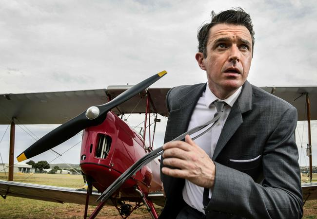 Actor Matt Day recreates a scene from North by Northwest in front of a Tiger Moth biplane at Classic Jets Fighter Museum, Parafield Airport. Picture: Bianca De Marchi