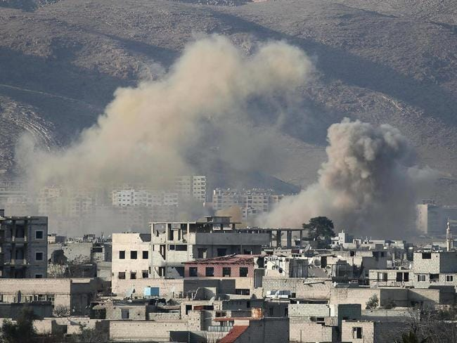 Smoke billows from an attack in a rebel-held town in Syria's east on March 3, 2018. Picture: Abdulmonam Eassa / AFP