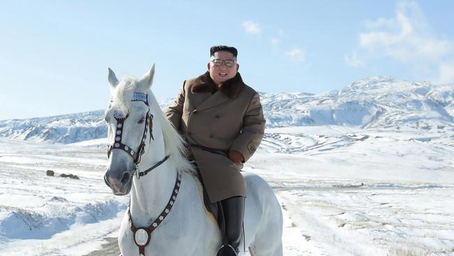 Photos of North Korean leader Kim Jong-un riding a white horse to climb Mount Paektu have raised serious questions. Picture: Korean Central News Agency/Korea News Service via AP