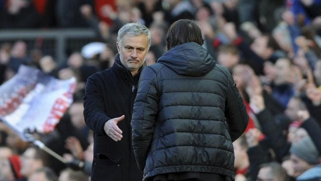 Manchester United coach Jose Mourinho, left, shakes hands with Chelsea's team manager Antonio Conte