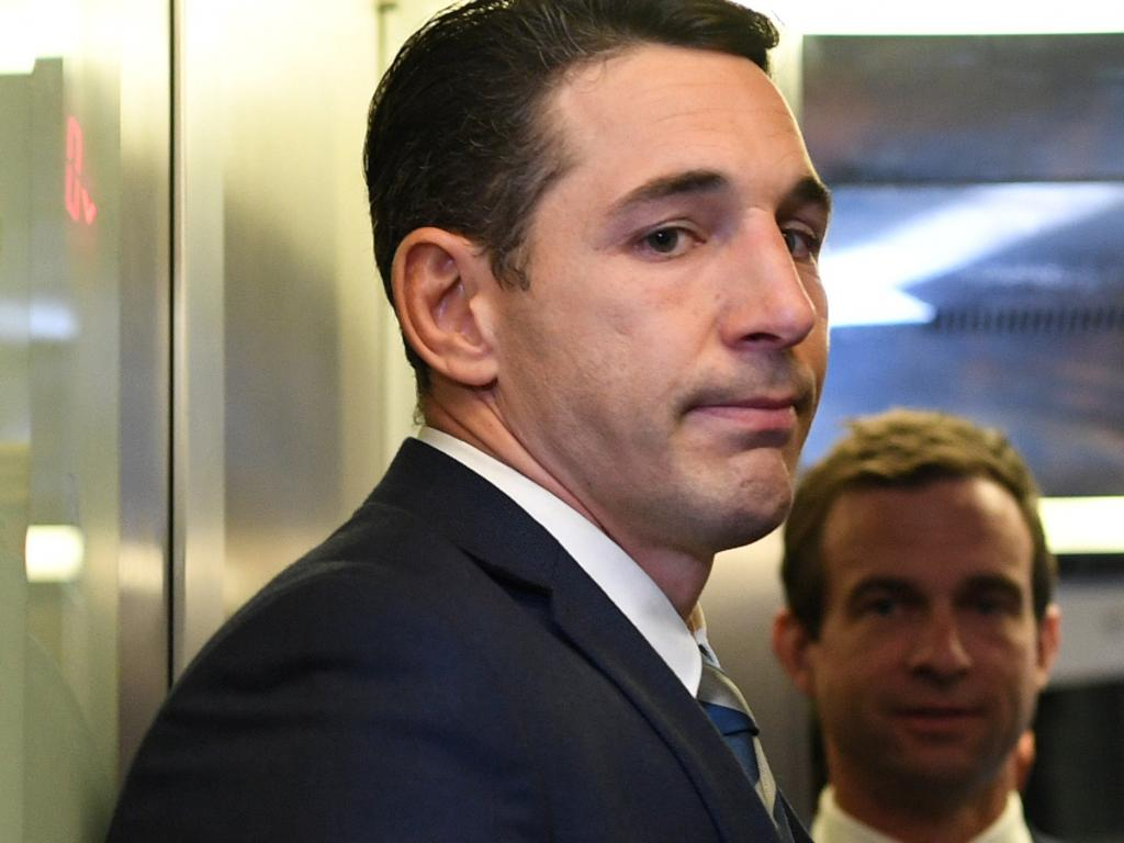 Melbourne Storm NRL player Billy Slater (left) is seen leaving NRL Central for his shoulder charge judiciary hearing in Sydney, Tuesday, September 25, 2018. (AAP Image/Brendan Esposito) NO ARCHIVING