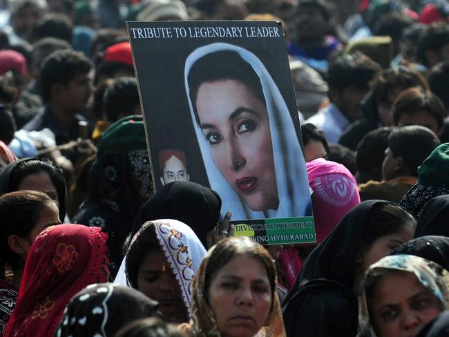 Pakistani supporters carry a portrait of former Pakistan premier Benazir Bhutto outside the Bhutto family mausoleum on the fifth anniversary of the assassination. Picture: Rizwan Tabassum/AFP