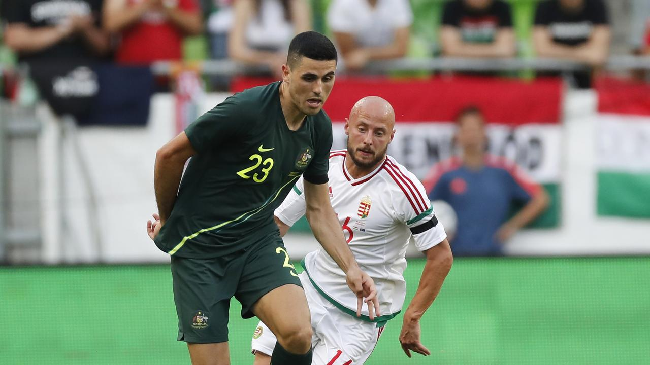Tom Rogic of Australia wins the ball from Jozsef Varga of Hungary