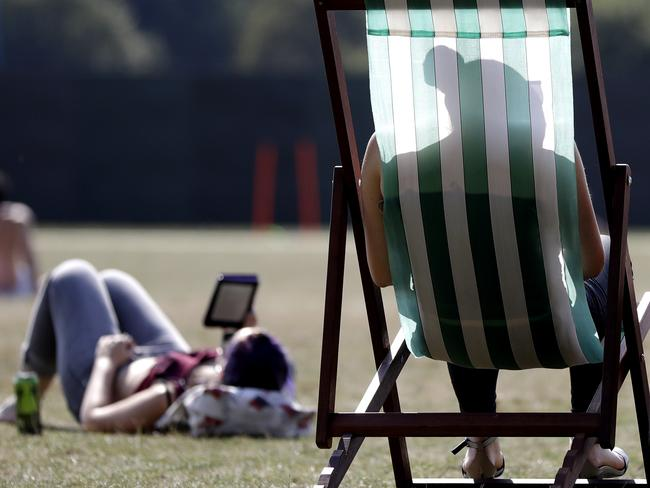 Londoners enjoy the sunshine in Hyde Park on the UK's hottest September day. Picture: AP Photo/Kirsty Wigglesworth