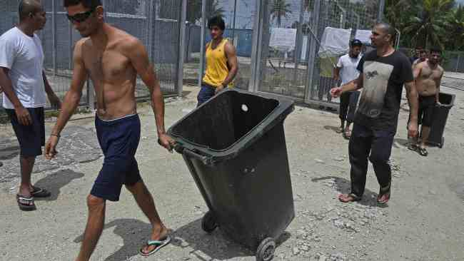 Asylum seekers are using bins to collect water. Photo: Brian Casey