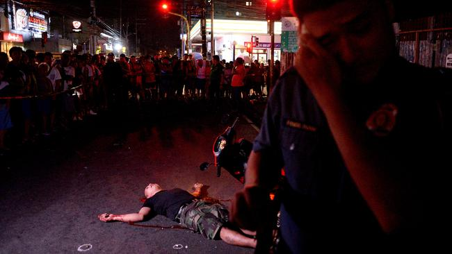 A crime scene where an alleged drug dealer was gunned down by unidentified men in Manila. Picture: AFP/ Noel Celis.