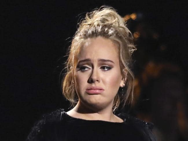Adele got a second go at her George Michael tribute - but looked heartbroken after she'd finished. Picture: Matt Sayles/Invision/AP