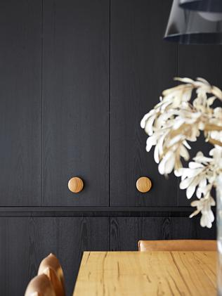 Circular timber handles are a theme. Picture: Tatjana Plitt