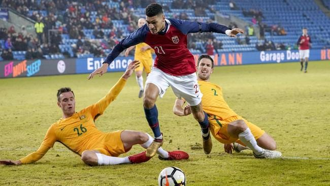 Norway's forward Bjorn Johnsen (C) vies for the ball with Australia's Aleksandar Susnjar (L) and Milos Degenek (R)