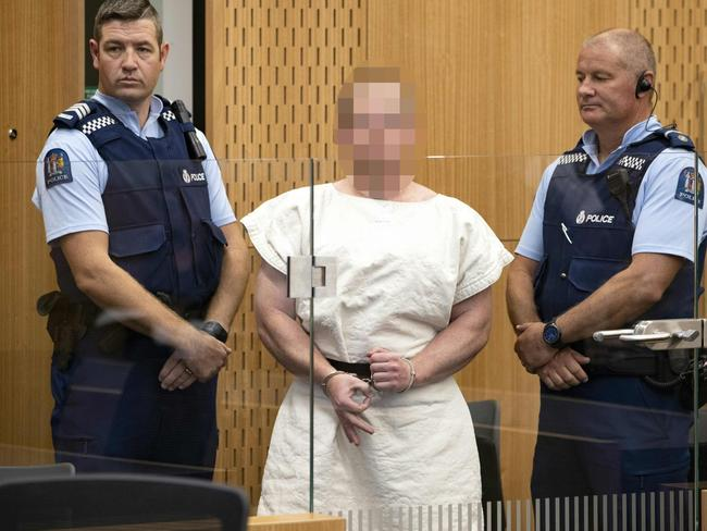Tarrant smirked and made a white supremacist gesture in court. Picture: Mark Mitchell/AFP