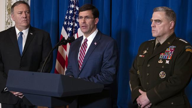 Secretary of State Mike Pompeo, left, and Chairman of the Joint Chiefs of Staff Gen. Mark Milley, right, listen as Secretary of Defence Mark Esper delivers a statement on Iraq and Syria. Picture: AP/Evan Vucci.