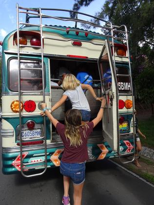 The girls hop on a chicken bus in Guatemala.