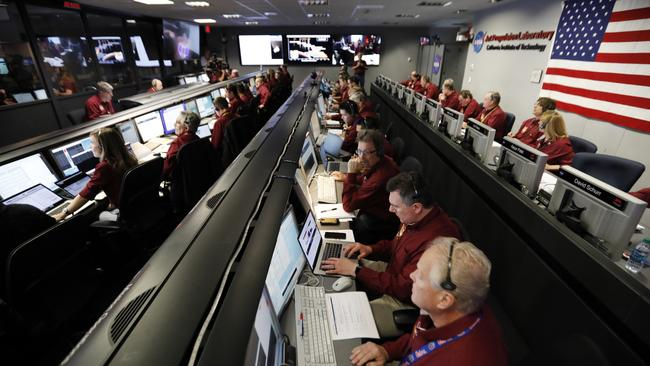 Engineers monitor the landing of InSight in the mission support area of the space flight operation facility at NASA's Jet Propulsion Laboratory. Picture: AP