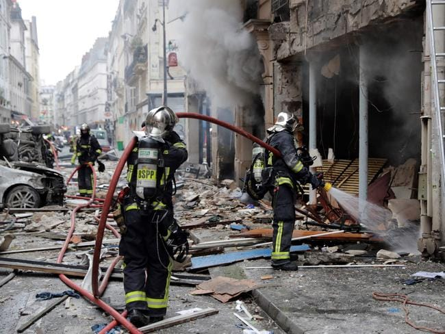 Firefighters intervene after the explosion of a bakery on the corner of the streets Saint-Cecile and Rue de Trevise in central Paris. Picture: AFP