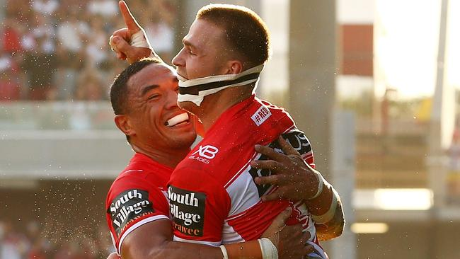 Euan Aitken of the Dragons celebrates scoring a try with Tyson Frizell.