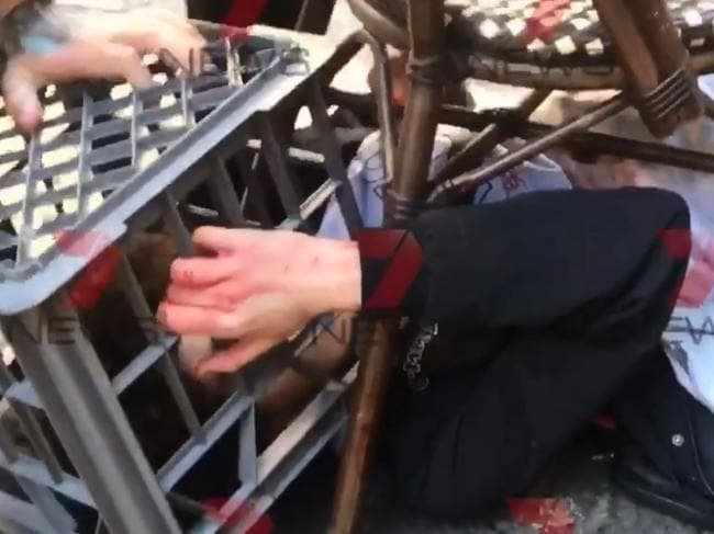 The man was trapped with a milk crate. Picture: Channel 7