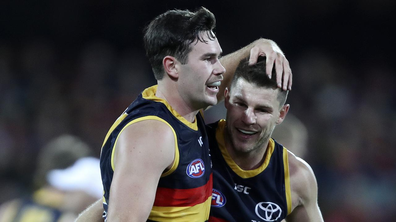 Mitch McGovern congratulates Bryce Gibbs on a goal. Picture SARAH REED