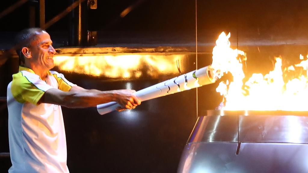 4ab07c712e04 Former athlete Vanderlei de Lima lights the Olympic cauldron during the  opening ceremony.