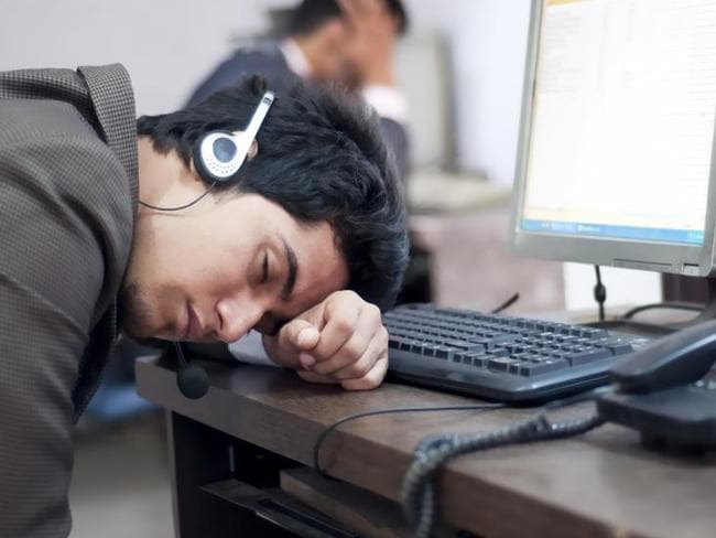 Not productive ... workers are not necessarily using extra time at work to get extra work done. Picture: Supplied.