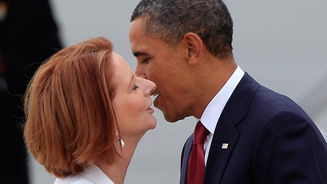 Barack kisses Julia after arriving in Canberra yesterday. Picture: Getty Images