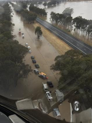Flooding on the Hume Freeway yesterday left cars and trucks stranded. Picture: Victoria Police