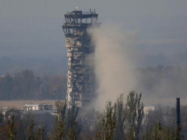 A Ukrainian flag flies over the traffic control tower of Donetsk airport.