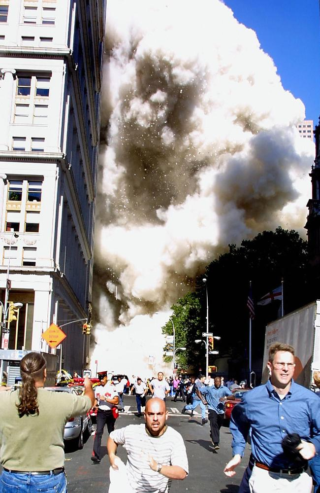 Terrified people run for their lives as the Twin Towers collapse in New York City. Picture: Doug Kanter/AFP