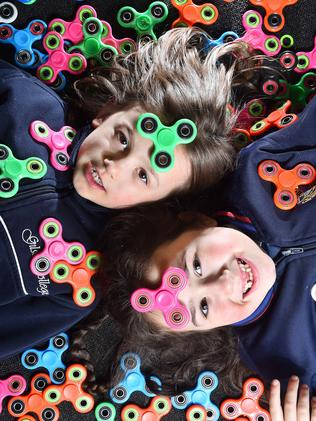Elyse and Ava swimming in fidget spinners. Picture: Rob Leeson.