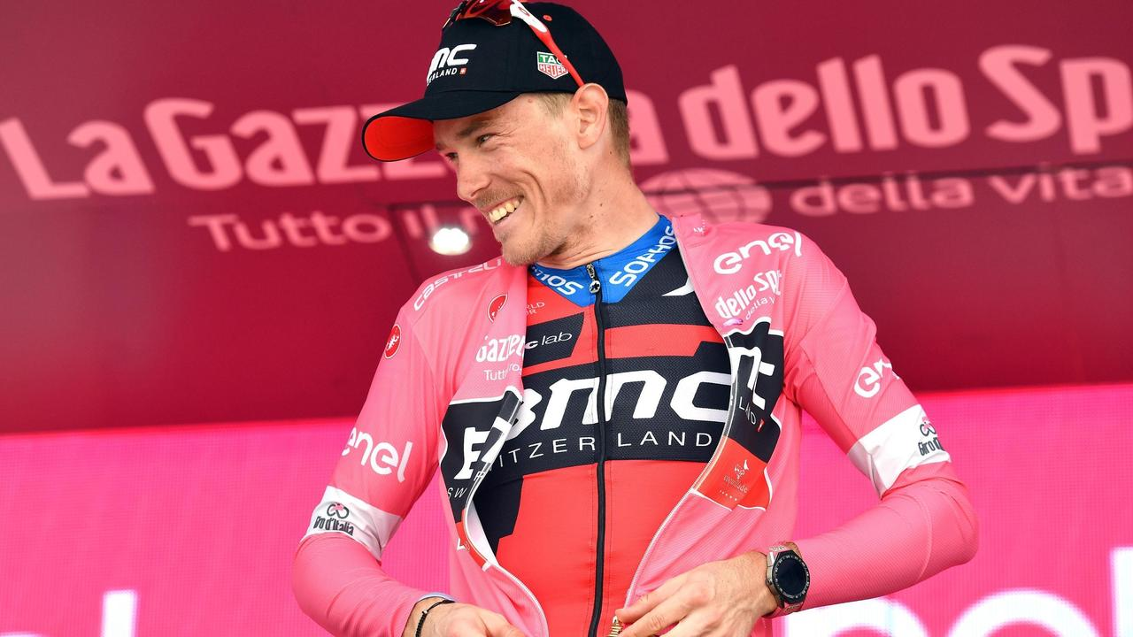 c43568087 ... Giro d Italia. Australia s Rohan Dennis pulls on the pink jersey as the  overall leader after completing the fifth