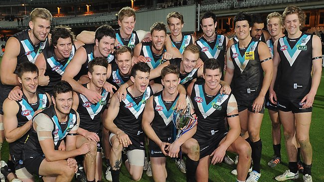 Port Adelaide players celebrate their victory with the cup after the AFL European Challenge Game against the Western Bulldogs at The Oval. Picture: Christopher Lee