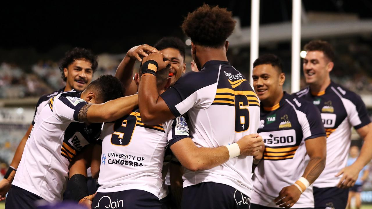 Nic White of the Brumbies celebrates with his team mates after scoring. (Photo by Mark Kolbe/Getty Images)