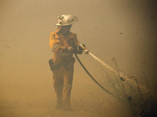 Fire crews battle bushfires at Little Mountain on the Sunshine Coast. Picture: Lachie Millard