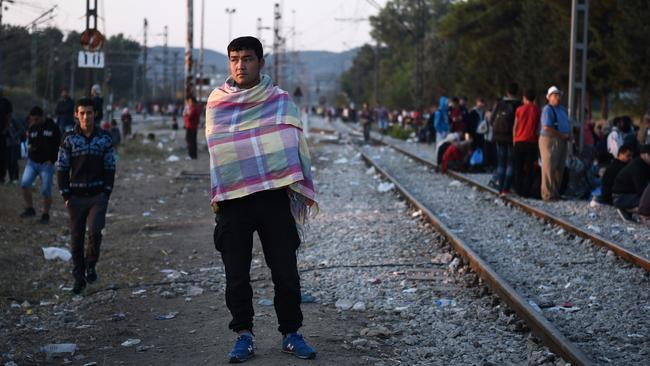 Refugee advocates would tell you this man needs a bed and a hot meal, not a gun waved in his face. Picture: AP Photo/Giannis Papanikos