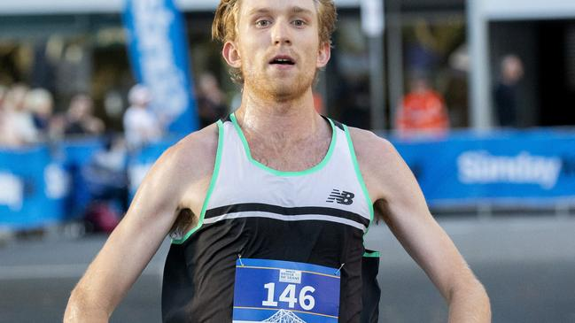 Jack Bruce crosses the finish line at the Bridge to Brisbane 2019 at South Bank, Sunday, August 25, 2019 (AAP Image/Richard Walker)
