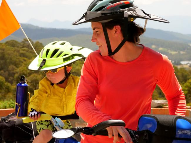 Young Wily rides behind mum Nicola Hughes on the yellow bike. Picture: SWAG FAMILY/ ADVENTURE LEARNING AUSTRALIA