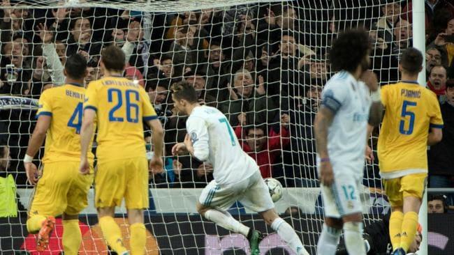 Real Madrid's Portuguese forward Cristiano Ronaldo (C) celebrates scoring the winning penalty