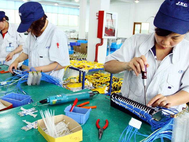 Chinese workers assembling computers in China's Zhejiang province. Pic: AFP.