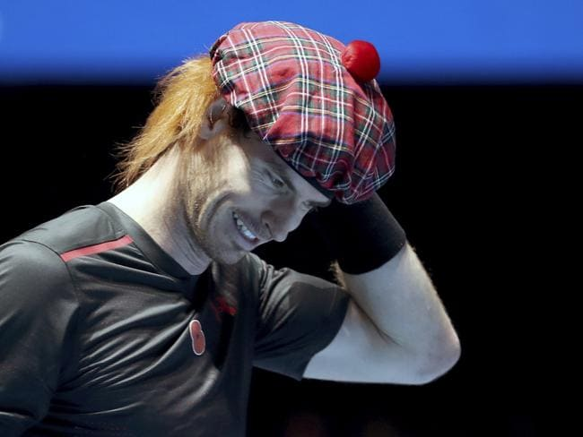 Andy Murray wears a traditional Scottish tam o' shanter tartan hat with added ginger hair, as plays against Roger Federer, in their friendly singles match.