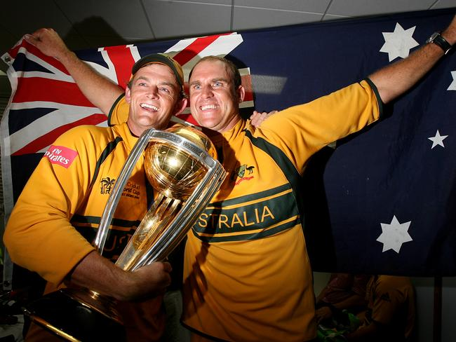 Gilchrist and Hayden in the changerooms with the Cup.