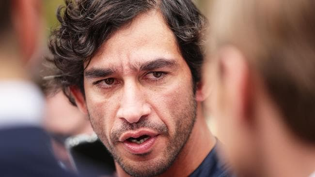 Johnathan Thurston of the Cowboys looks on.