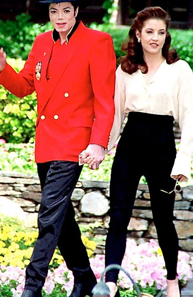 Michael Jackson and Lisa Marie Presley strolling in the grounds of Neverland in 1995.