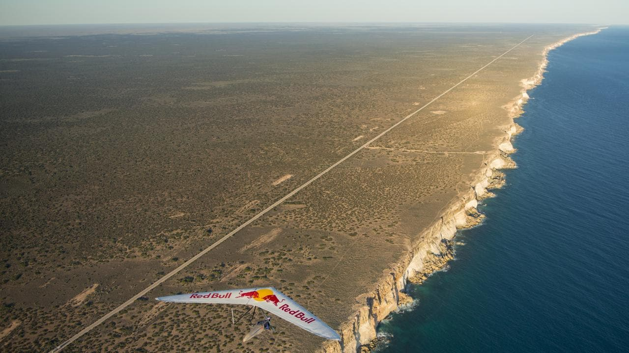 The Nullarbor Plain is a flat, almost treeless, dry area of land along the Great Australian Bight coast of WA and SA. You can see the Eyre Highway below Jon Durand's hang-glider. This picture was taken in 2014 near Eucla.