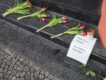 Flowers and a sign reading (Translation: Defy terror, protect freedom) outside the Belgium embassy in Berlin on March 22, 2016. Picture: AFP PHOTO / ODD ANDERSEN