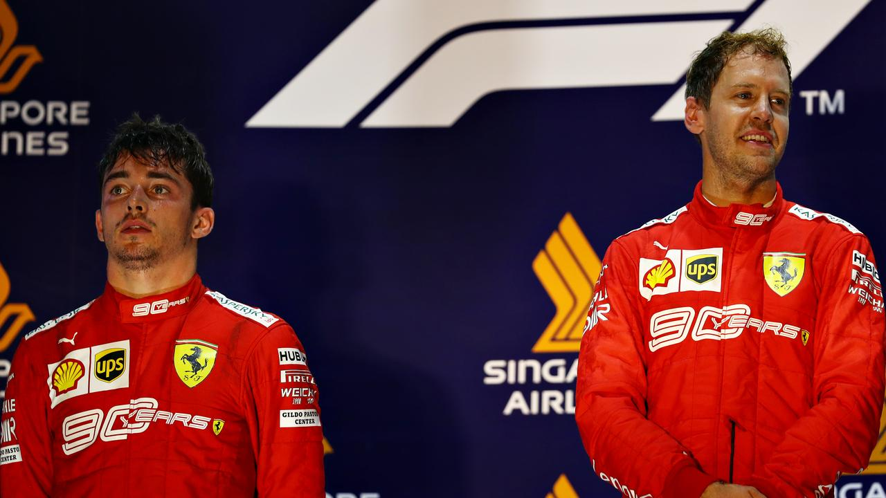 Charles Leclerc (L) and Sebastian Vettel on the podium in Singapore.